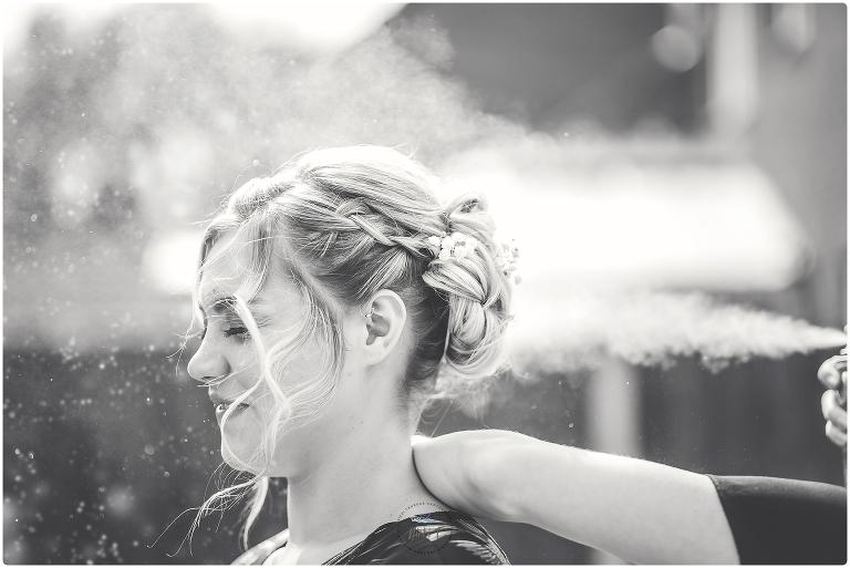 spraying glitter on brides hair