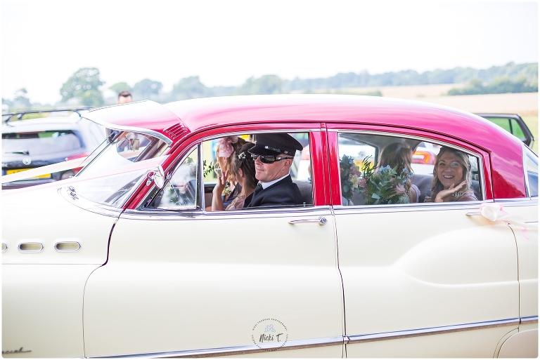 bridesmaid waving as car goes past